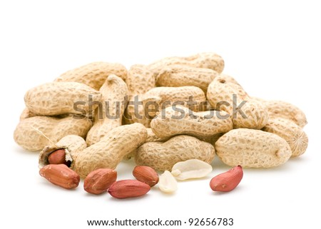 Peanuts in shells focus on front exposed peanuts.