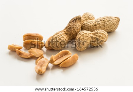 peanuts in shells on white isolated