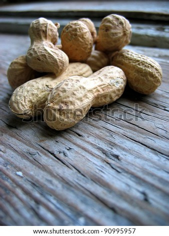 Peanuts in the shell on an old retro window sill