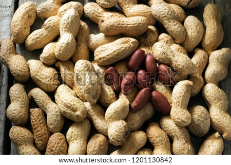 Peanuts on the wooden table. #1201130842