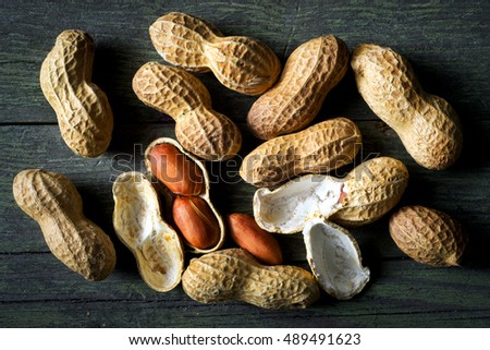 peanuts  on wooden table #489491623