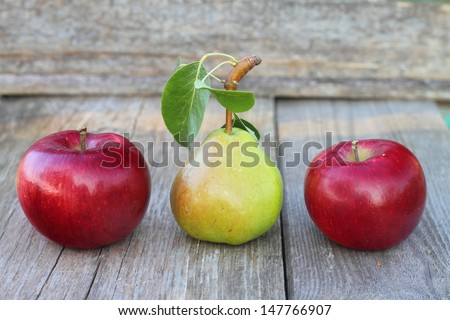 pear and apples on an old table