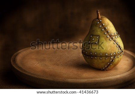 pear manipulated fruit with nails holding it together genetic manipulation gmo concept genetically altered food
