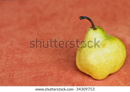 Pear on a reddish craquelure background