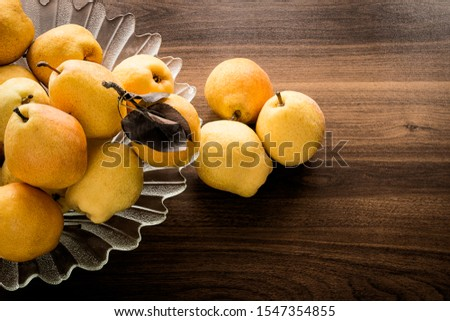 Pear - Pear and pear platter on wooden table #1547354855