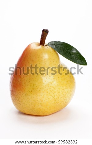 Pear with a green leaf on a white background