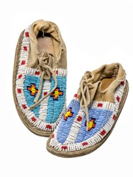 Pearl-embroidered moccasins of the North American Indians isolated on white