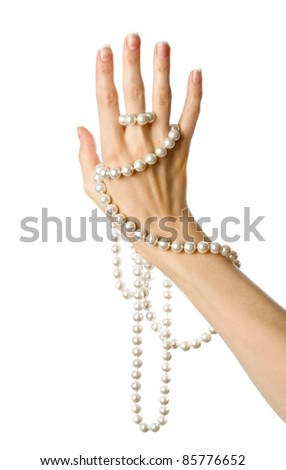 Pearl in the woman hand