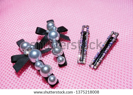 Pearl Jewelry.pearl hair clip. Fashion and design pearls on pink background. #1375218008