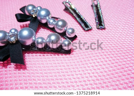 Pearl Jewelry.pearl hair clip. Fashion and design pearls on pink background. #1375218914