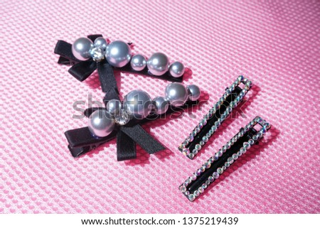 Pearl Jewelry.pearl hair clip. Fashion and design pearls on pink background. #1375219439