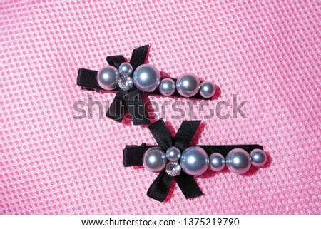 Pearl Jewelry.pearl hair clip. Fashion and design pearls on pink background. #1375219790