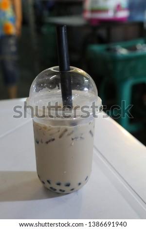 Pearl milk tea on the table in the night market #1386691940