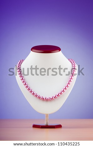 Pearl necklace against gradient background