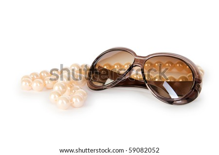 Pearl necklace and sunglasses isolated on the white background