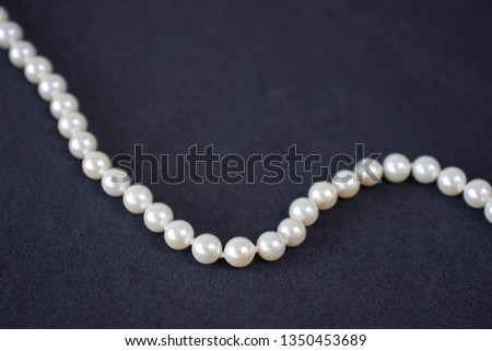 Pearl necklace on a black background #1350453689