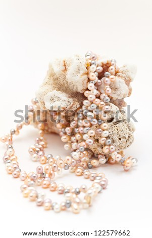Pearl necklace on a coral