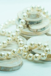 pearl necklace on pieces of wood