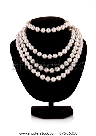 Pearl necklace on support isolated on white
