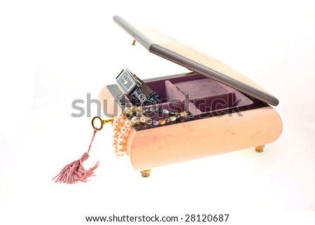 pearl necklaces and watch in pink wood encrusted box for jewelry on a white background