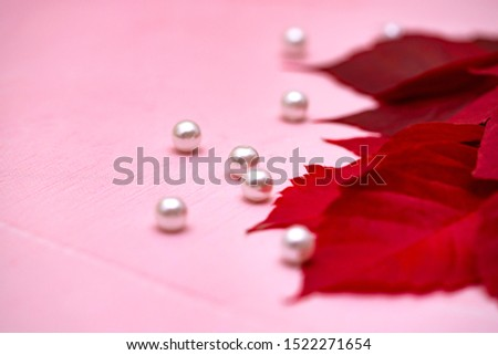 pearl on a pink background with red autumn leaves #1522271654