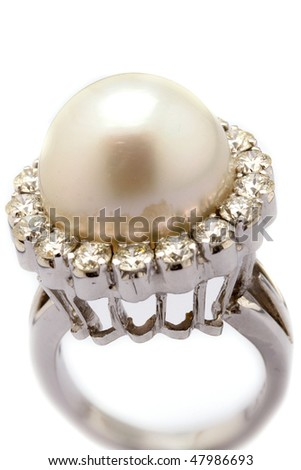 Pearl ring on white - stock photo