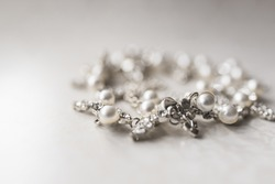 Pearl silver necklace on a white background