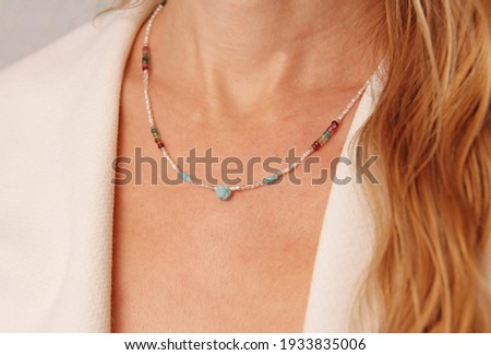 Pearls and natural stones necklace. A short necklace on a girl made of natural stones . Handmade jewelry made from natural stones. Modern jewelry. Сток-фото ©