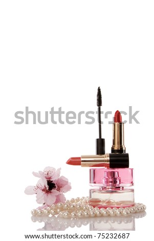 Pearls beads, cosmetics and cherry flower on white background