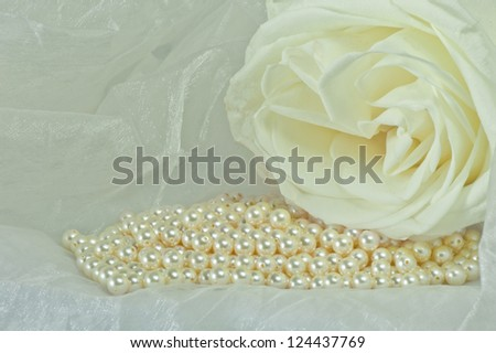 pearls scattered on a colored background fabric