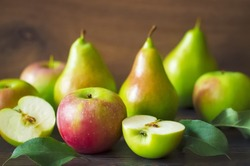 pears and apples close up on wooden background. autumn harvest of apples and pears.