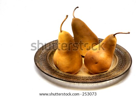 Pears On a Silver Platter photographed on white. - stock photo