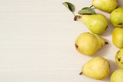 Pears on the light wooden background