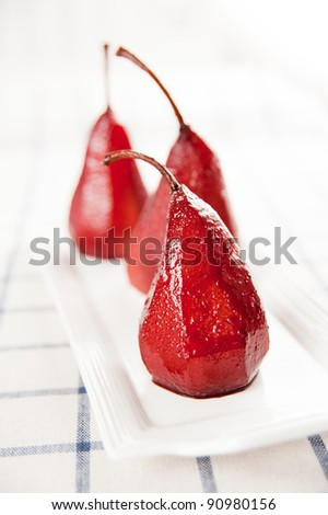 Pears Poached in Red Wine with Pomegranate Seeds