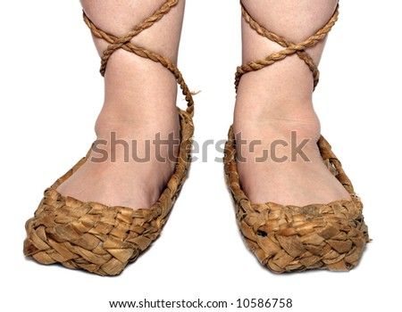 peasant woman legs in russian bast shoes isolated on white