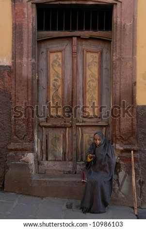 Peasant woman sitting in doorway in San Miguel de Allende, Mexico