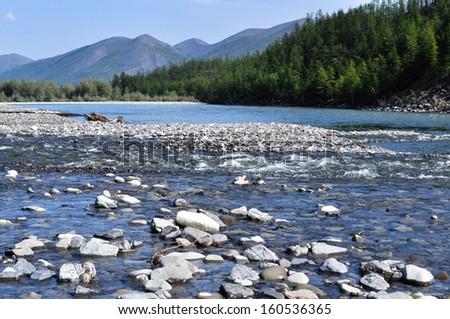 Pebble Bank of a mountain river. Russia, Yakutia, A Ridge Of Suntar-Khayata.