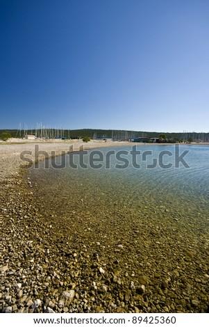 Pebble beach in the Sukosan marina