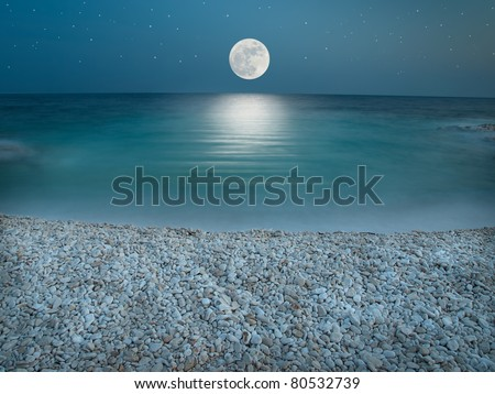 Sky with stars, lit by the full moon just above horizon - stock photo