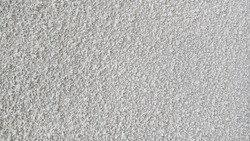 pebble dash wall. painted rough stone surface