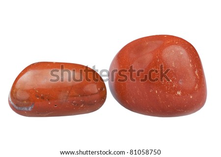 Pebble of mineral of red jasper it is isolated on white background
