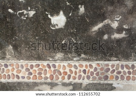 Pebble paving on lime wall
