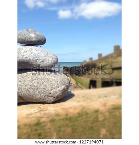 Pebble sat on a pebble sat on a pebble sat on the beach