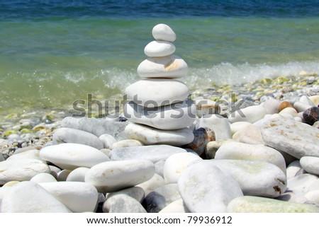 Pebble stack on seashore