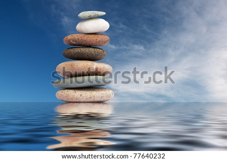 pebble stack with water reflection
