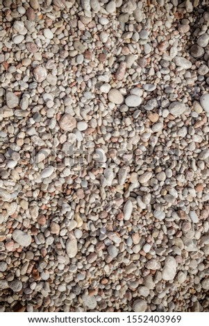 Pebble stone background.Small colorful pebbles background, simplicity, daylight, stones.smooth waterworn pebble use for garden decoration.Relaxing on the beach.abstract background with round peeble