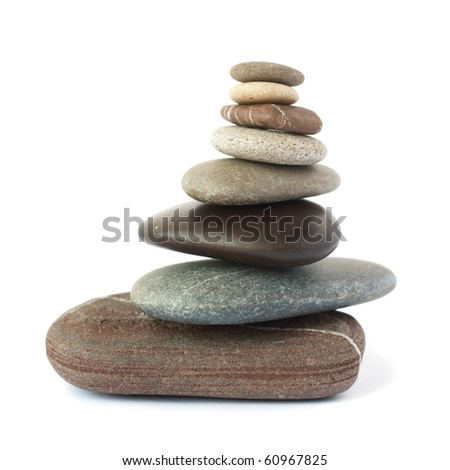 Pebble stones tower isolated on white background.