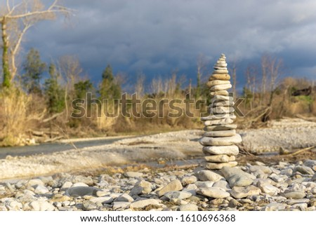 Pebble tower near French river in drome. Zen, relaxation and tranquility