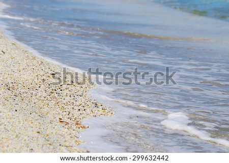 pebbles by the shore in Stintino, Italy