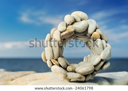 Pebbles combined on a circle on a coast
